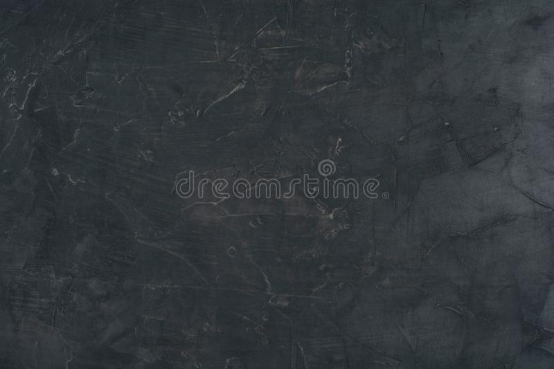 Top view of grungy dark concrete wall for background stock photo