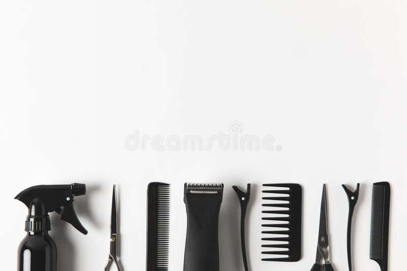 Top view of hair clipper and hairdressing tools in row,. On white stock photos