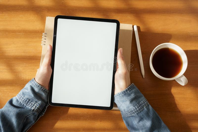 Top view hand of asian women are using tablet on wood table royalty free stock photography