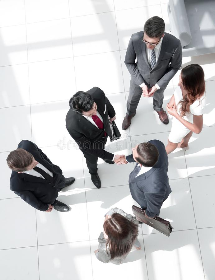 Top view. handshake business partners at the meeting stock image