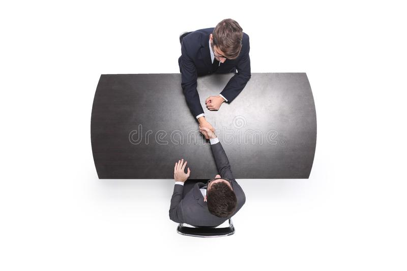 Top view. handshake business people at the meeting royalty free stock images