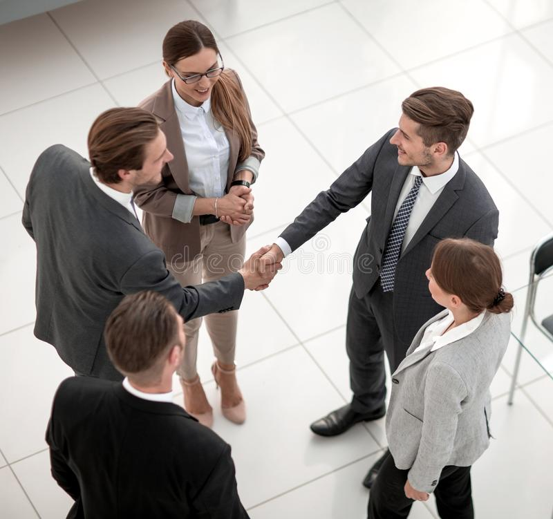 Top view.handshake trading partners in the office royalty free stock images