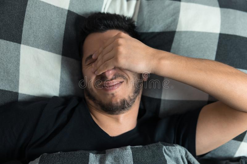 Top view of handsome man yawns royalty free stock photos