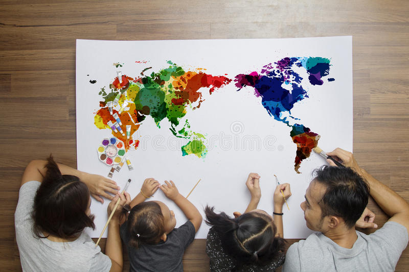Top view happy family lying on floor with painting watercolor world map on paper background royalty free stock photography