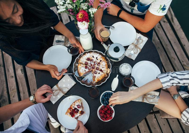 Top view of happy friends eating pie together royalty free stock image