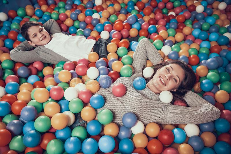 Top view. Happy mom and son in pool with balls stock images