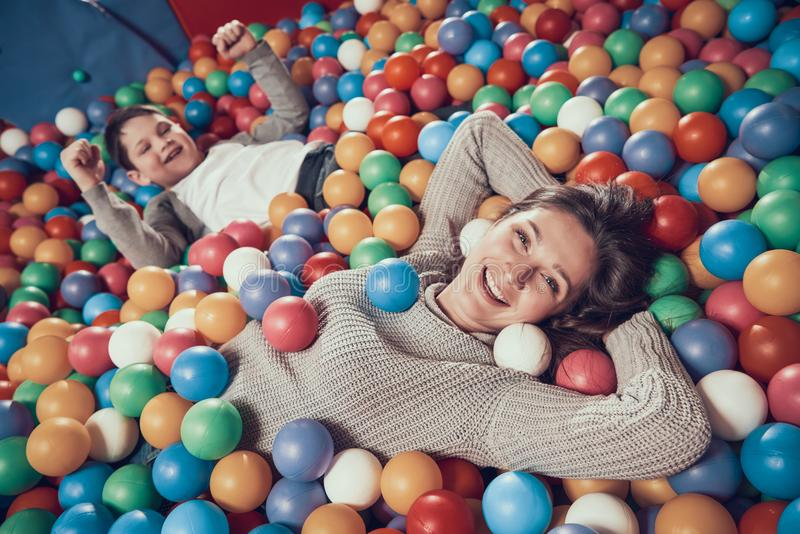 Top view. Happy mom and son in pool with balls royalty free stock image