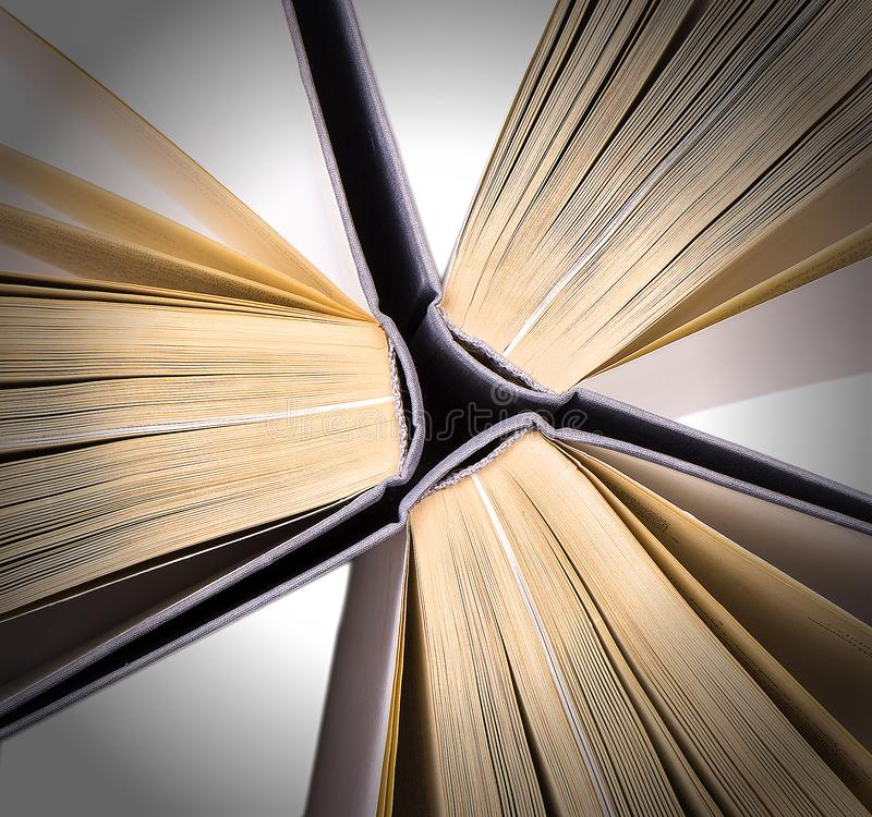 Top view of hardback books in a circle. Open book, fanned pages. Back to school copy space. Education background royalty free stock photography