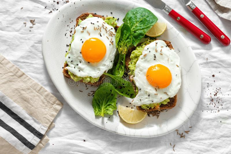 Top view healthy avocado toasts breakfast lunch avocado toast fried eggs white background stock photography