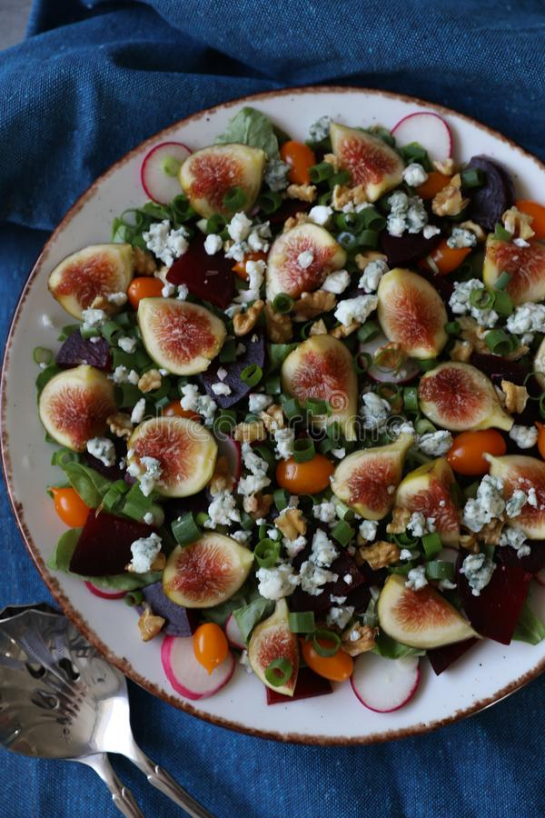 Top view of healthy and delicious fresh Figs,Gorgonzola cheese and beetroot salad royalty free stock photography