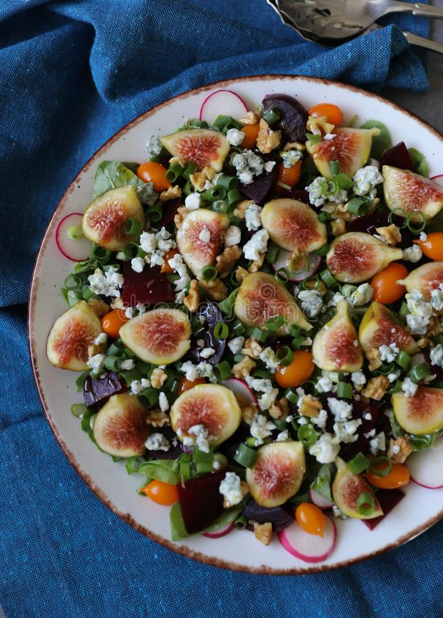 Top view of healthy and delicious fresh Figs,Gorgonzola cheese and beetroot salad royalty free stock image
