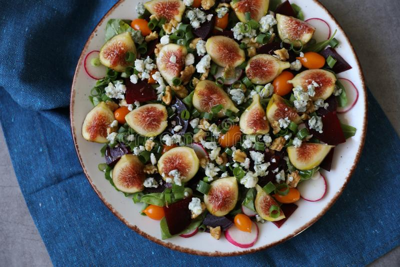 Top view of healthy and delicious fresh Figs,Gorgonzola cheese and beetroot salad stock images