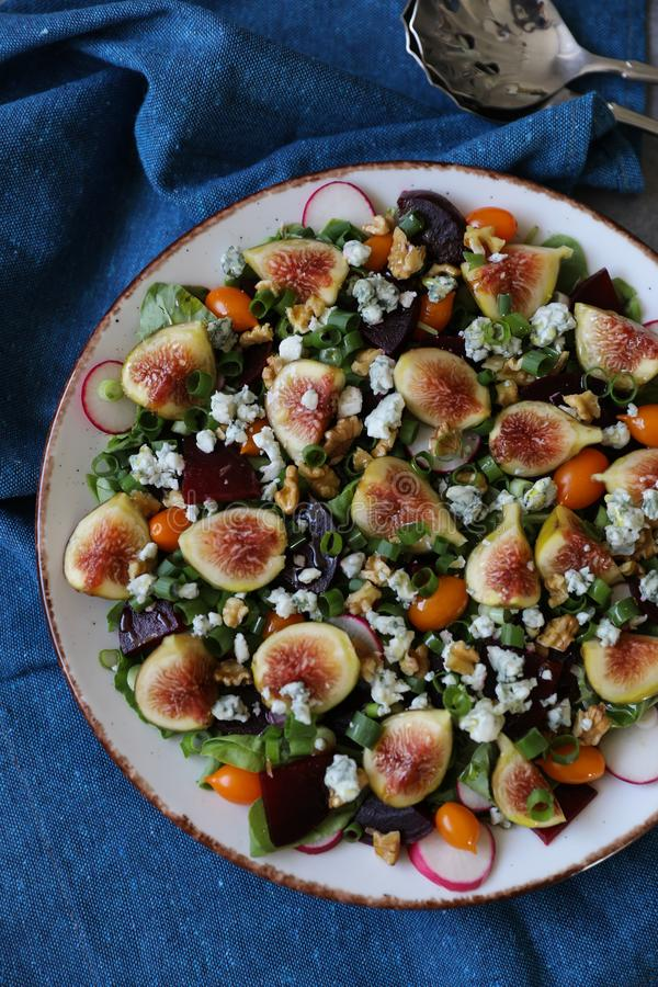 Top view of healthy and delicious fresh Figs,Gorgonzola cheese and beetroot salad stock photo