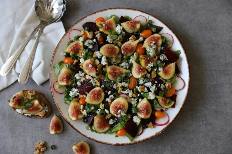 Top view of healthy and delicious fresh Figs,Gorgonzola cheese and beetroot salad royalty free stock images