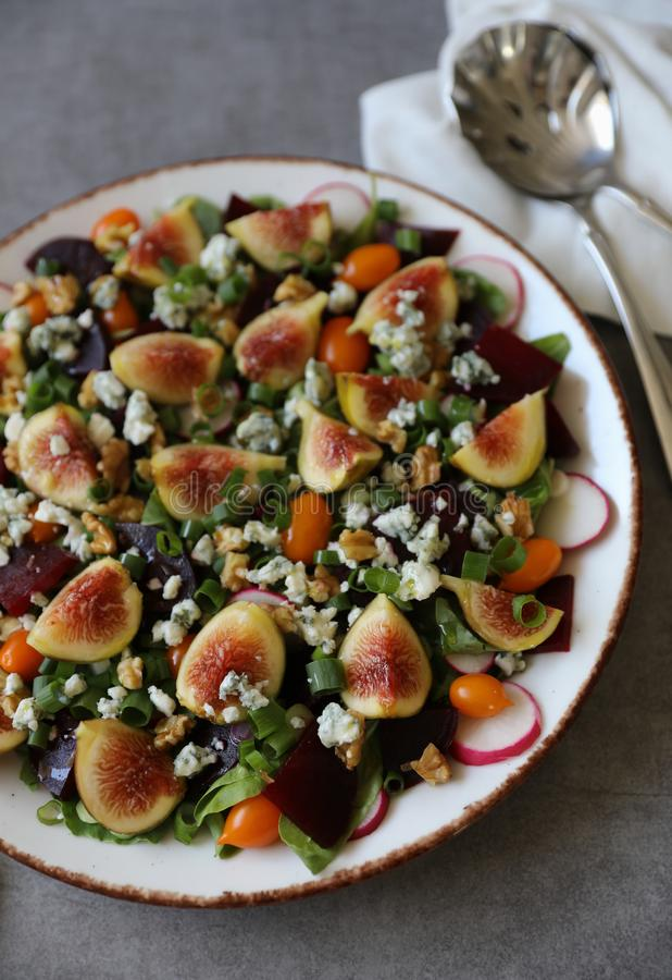 Top view of healthy and delicious fresh Figs,Gorgonzola cheese and beetroot salad stock photos