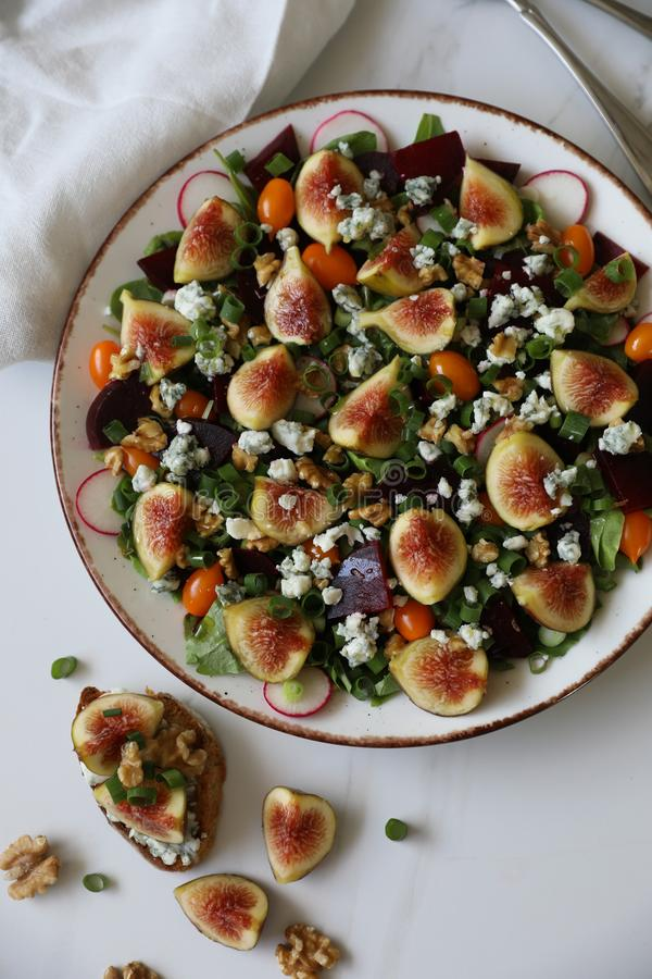 Top view of healthy and delicious fresh Figs,Gorgonzola cheese and beetroot salad stock photography