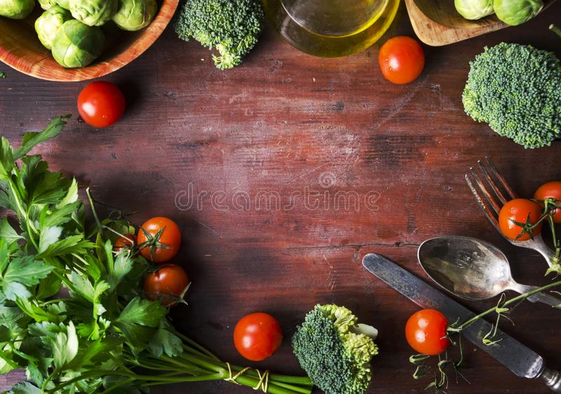 Top view of healthy food ingredients frame on vintage wooden table. Superfood vegetable mix border on rustic background from above stock image