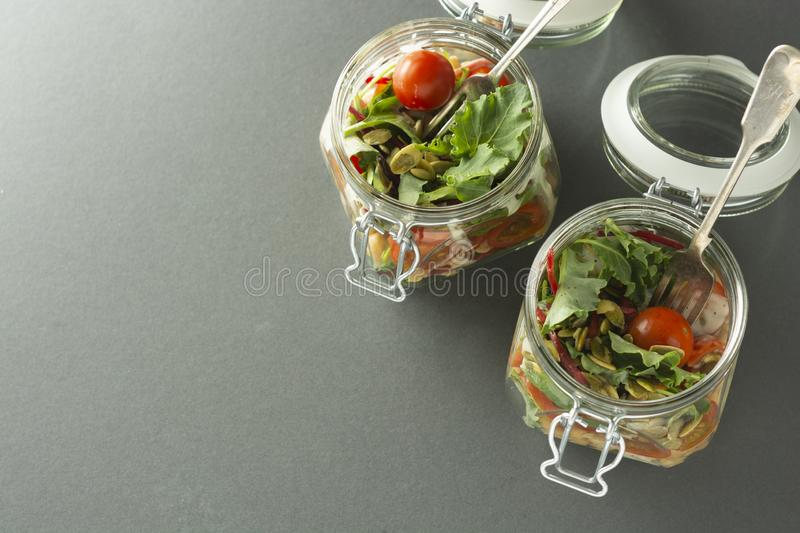 Top view healthy salad in glass jar. Healthy food, diet, detox, clean eating. Lunch box, copy space stock photo