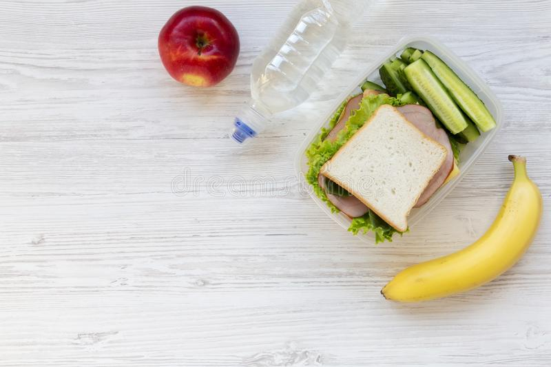 Top view, healthy school lunch box with sandwich, fruits and bot royalty free stock image