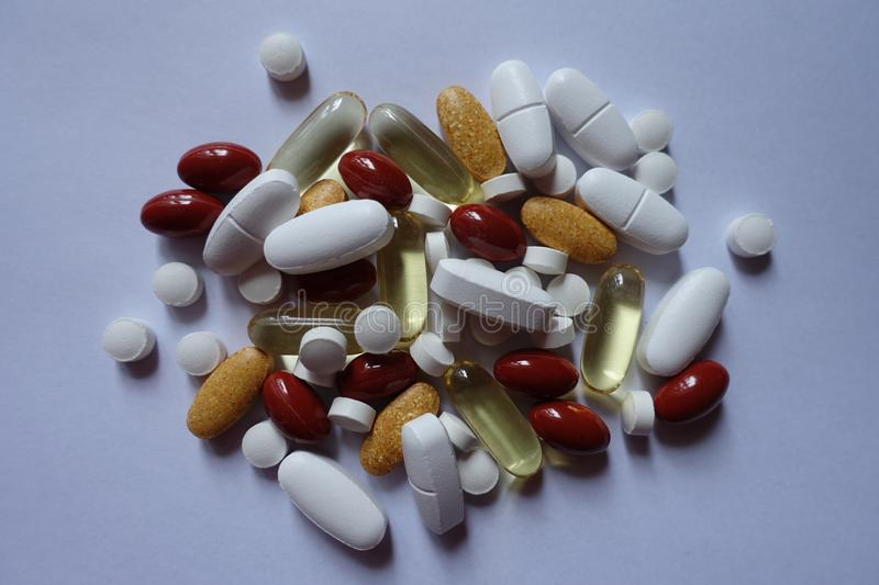Top view of heap of 5 types of pills. Top view of heap of five types of pills royalty free stock image