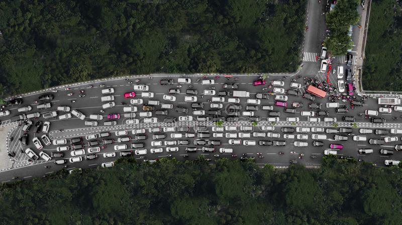 Heavy traffic at the peak hour. Top view of heavy traffic with motorcycles and cars on the highway at the peak hour royalty free stock photo