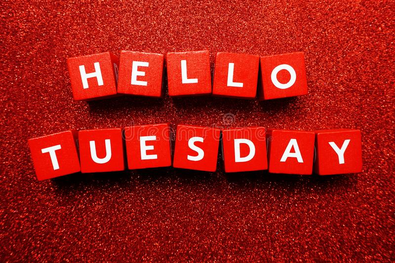 Top view of Hello Tuesday alphabet letter. Hello Tuesday alphabet letter with space copy on red glitter background stock photos