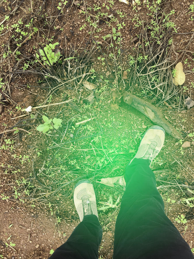 Top View of Hiking boots from above,one person feet in Hiking boots, standing at frontier line. Top View of Hiking boots from above,one person feet in Hiking royalty free stock photos