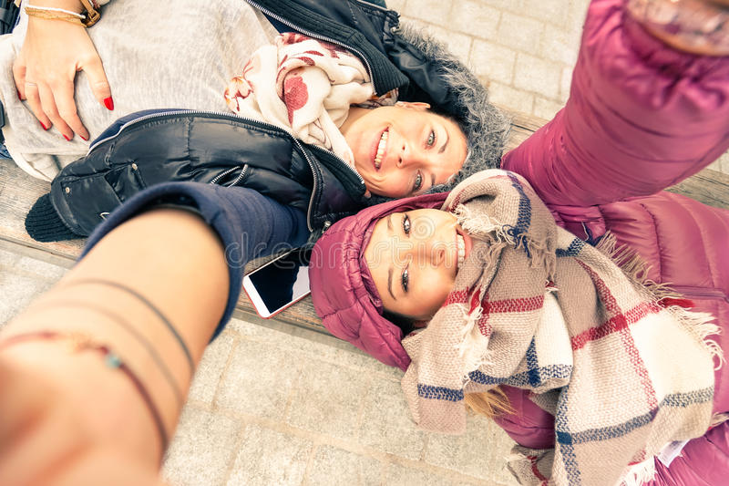 Top view of hipster best friends girlfriends taking selfie royalty free stock image