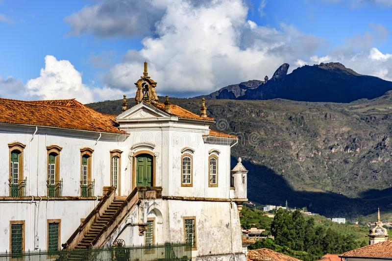 Top view of historic Ouro Preto city in Minas Gerais. Brazil with its famous churches and old buildings with hills in background royalty free stock photos