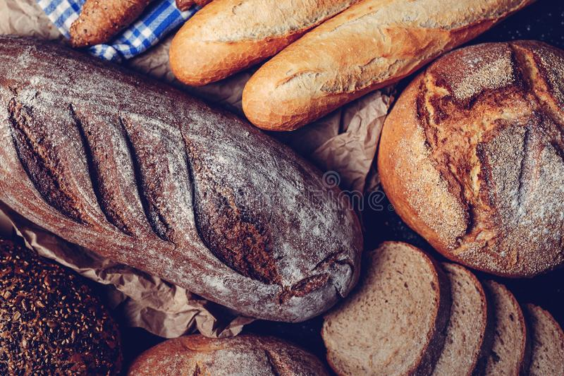 Top view of a homemade bread, slices of whole grain bread and baguette. Top view of a homemade bread, slices of whole grain bread royalty free stock images