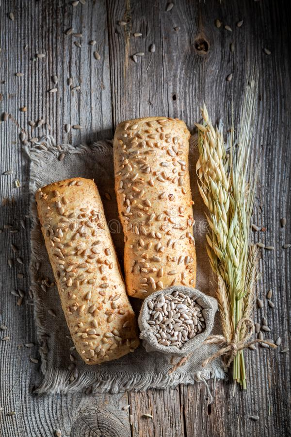 Top view of homemade ciabatta buns with sunflowers seeds royalty free stock image