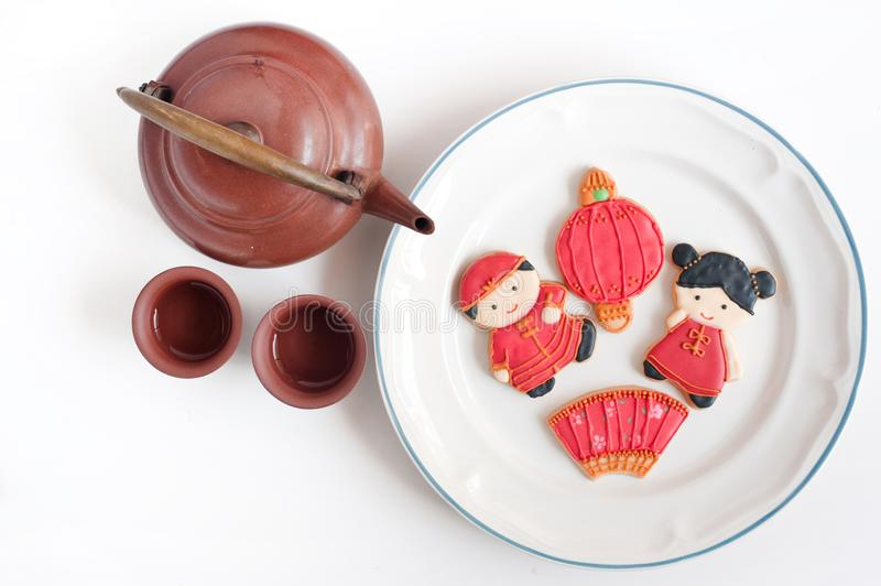 Top view of homemade gingerbread as Chinese boy and girl dolls i stock photos