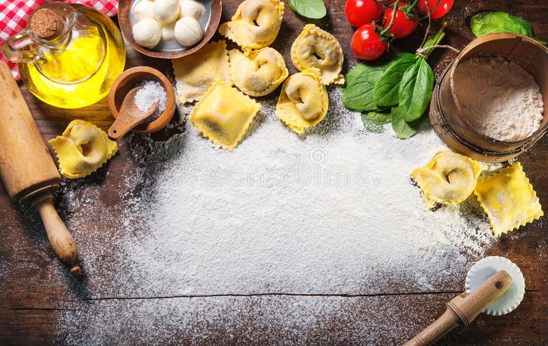 Top view on homemade pasta ravioli on old wooden table royalty free stock image