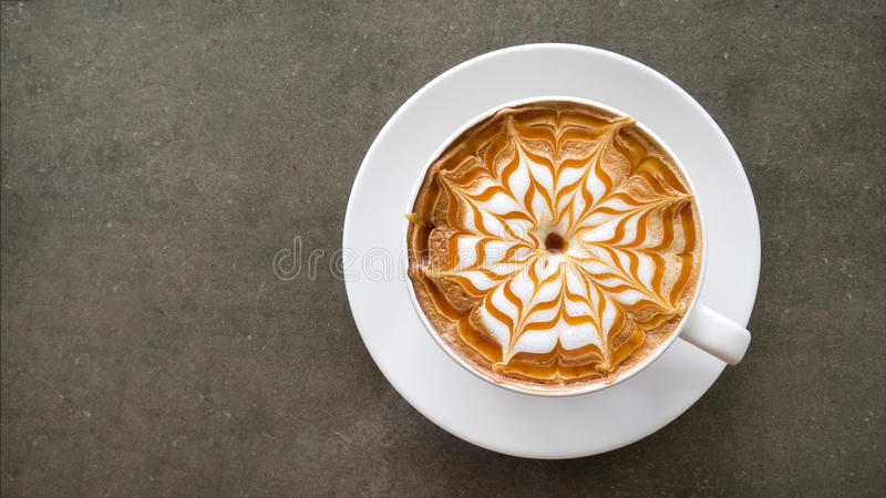 Top view of hot coffee cappuccino latte art top view on concrete table royalty free stock photo