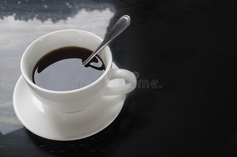 Top view of hot coffee in white ceramic cup, black and white tone.  royalty free stock photos