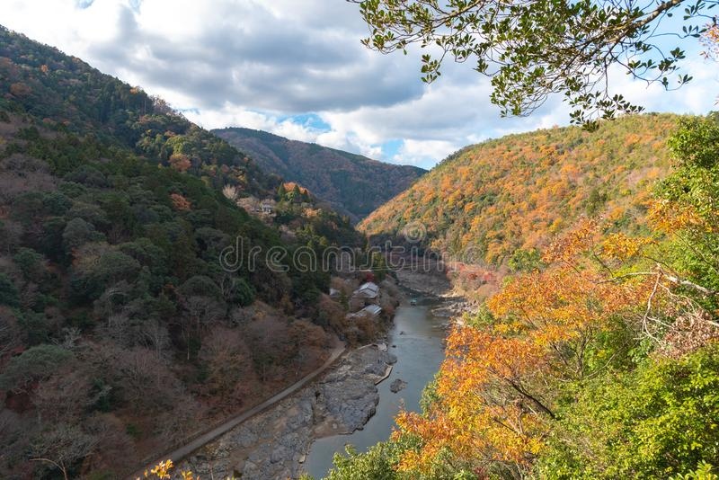 Top view of Hozugawa river with japanese traditional wooden house , boat and autumn foliage colors from Arashiyama view point, Kam stock photo