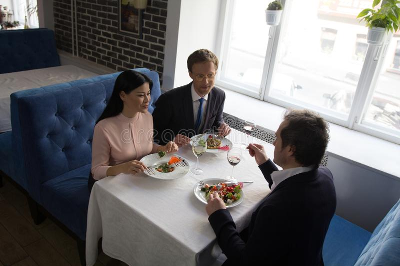 Business people having lunch at luxury restaurant stock image