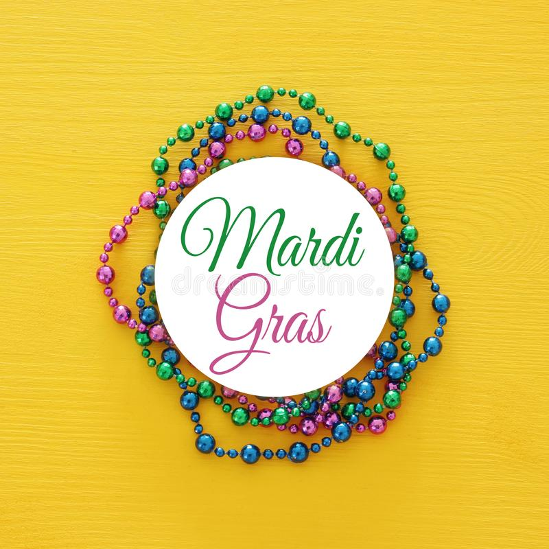 Top view image of colorful beads with text MARDI GRAS. Flat lay. stock images
