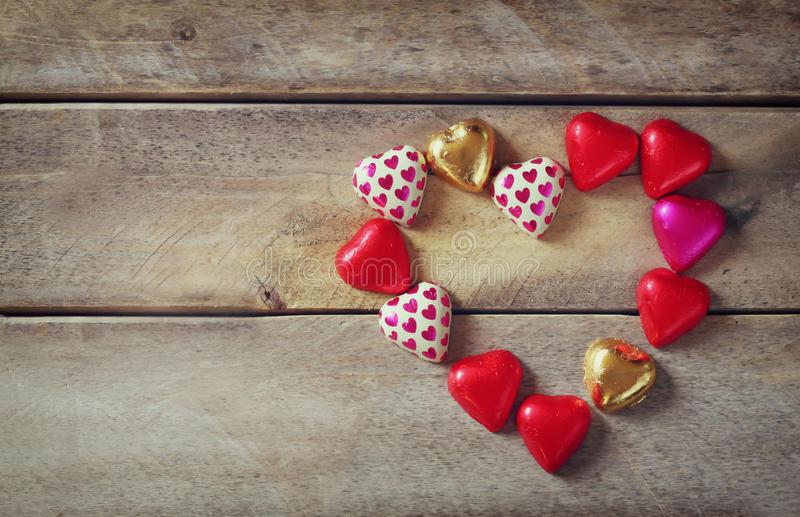 Top view image of colorful heart shape chocolates on wooden table. valentine's day celebration concept.  stock image