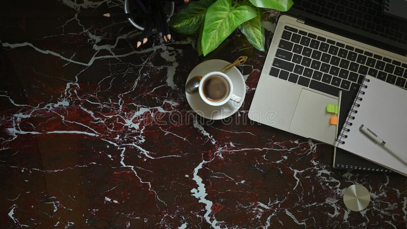 Top view image of computer laptop putting on marble texture table. royalty free stock image