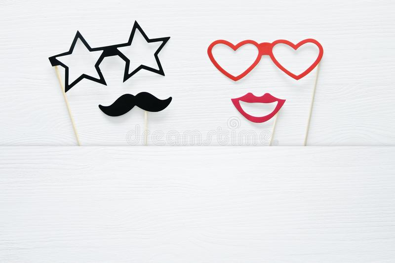 Top view image of funny and colorful photo booth props for party over white background. vector illustration