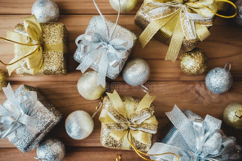 Top view image of golden and silver present boxes and Christmas decorations stock photography