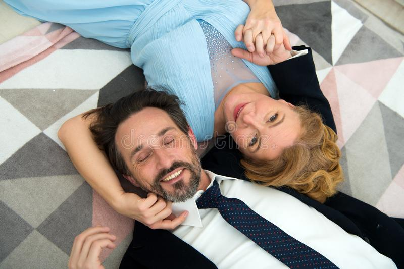 Top view image of happy gorgeous couple lying on bed stock photography