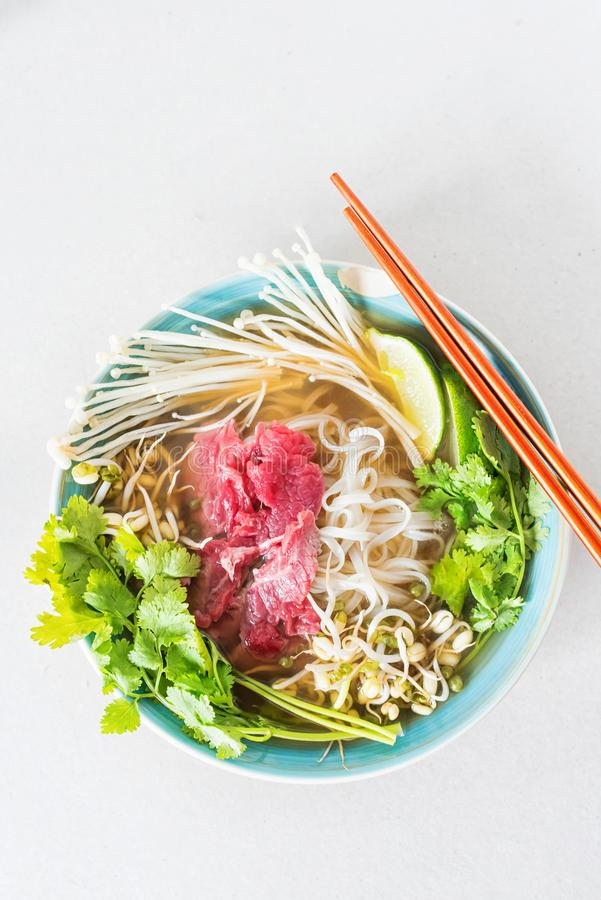 Top view of an image of hot soup Pho Bo royalty free stock photography