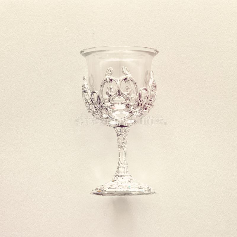 Top view image of jewish silver wine cup for wine. passover holiday and shabbat concept. Vintage filtered. stock photo
