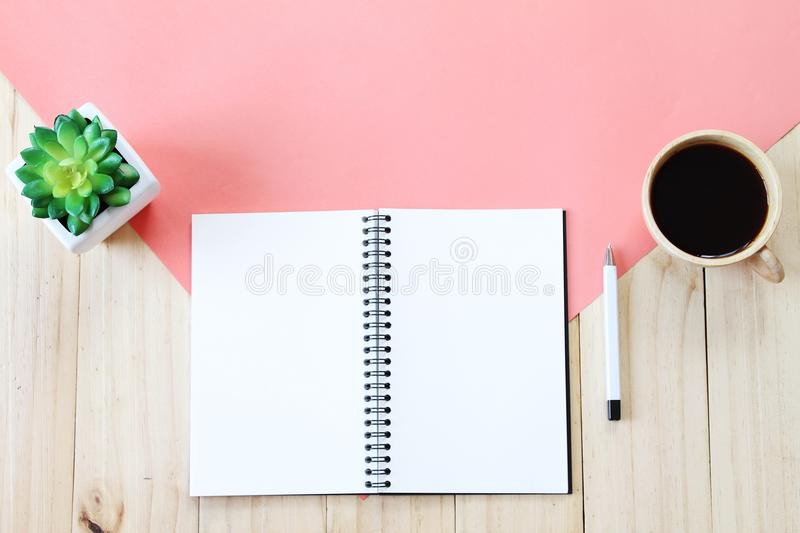Top view image of open notebook with blank pages, accessories and coffee cup on wooden background, ready for adding or mock up. Still life, business, office royalty free stock photos