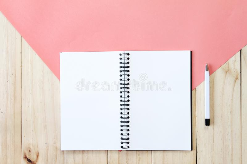 Top view image of open notebook with blank pages on wooden background, ready for adding or mock up. Still life, business, office supplies or education concept royalty free stock photography