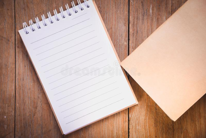 top view image of open notebook with blank pages on wooden table royalty free stock photo