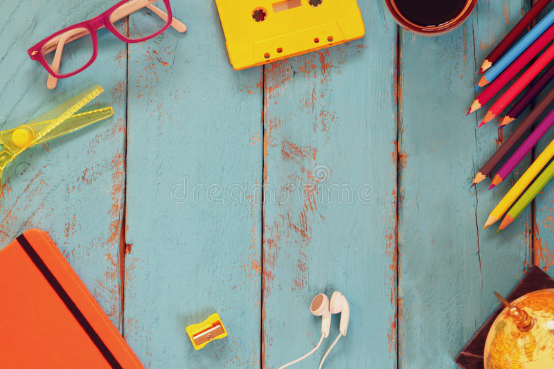 Top view image of school supplies on wooden table. vintage filtered. education concept stock photography