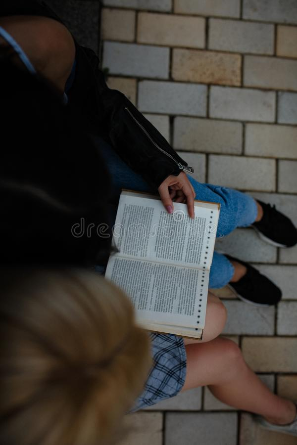 Cute lesbian couple read together. Top view image of two lesbian girls reading book together. Samesex love cincept royalty free stock photography